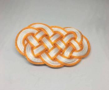 Knot_hairclip_orangewhiteoval