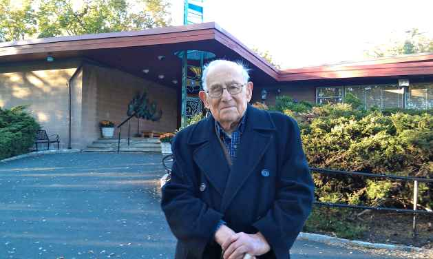 Leonard Abraham in front of Temple Beth Abraham in November 2011