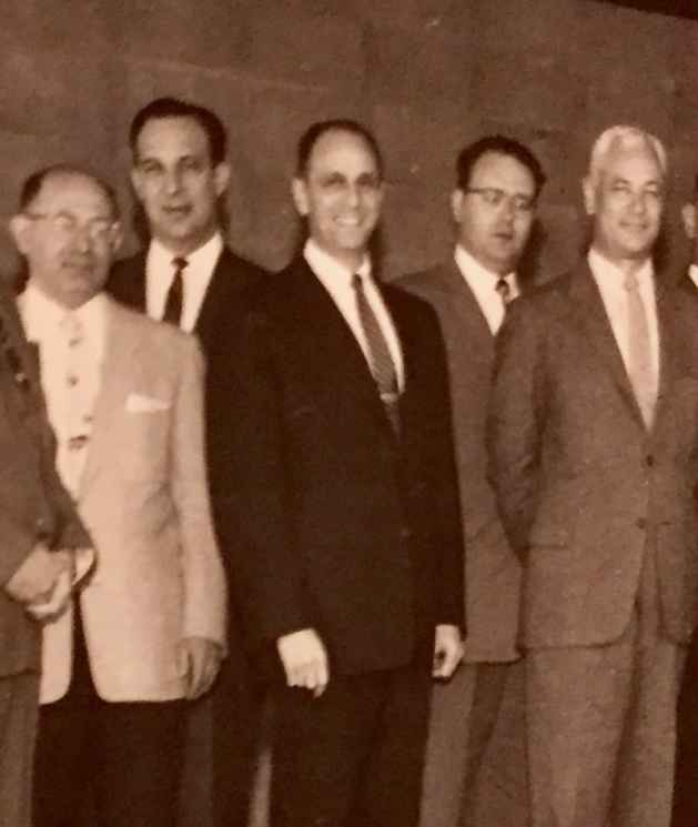 The Honorable Morrie Slifkin (center) with other temple board members
