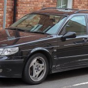 early 2000s black Saab parked
