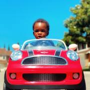 Kiddie luxury cars - Boy with red car
