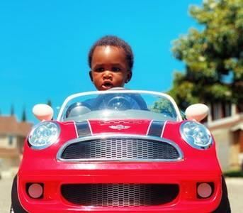 Kiddie luxury cars - Boy with red car