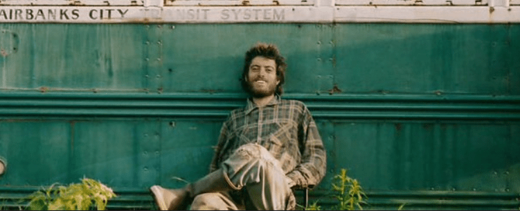Chris McCandless in from of the Into the Wild bus
