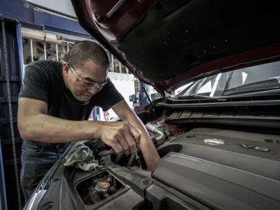 car engine repair in process by mechanic