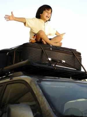 Child on car roof