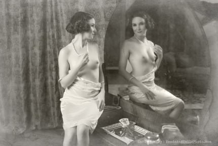 A boudoir scene (a first for this genre). Notice the mirror and vanity as well as the direct eye contact with the viewer. We have a very Voyeuristic look to this era.