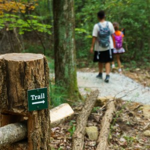 Hikers pass a trail marker on the Skyline Trail.