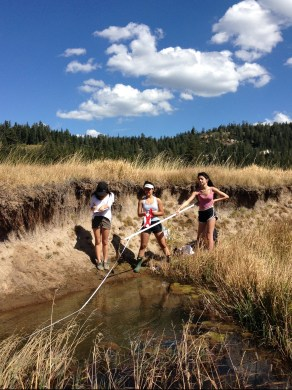 Three San Francisco University High School Girls measuring water quality in Van Norden Meadow.