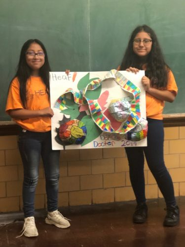 Two HEAF middle school students proudly display their project