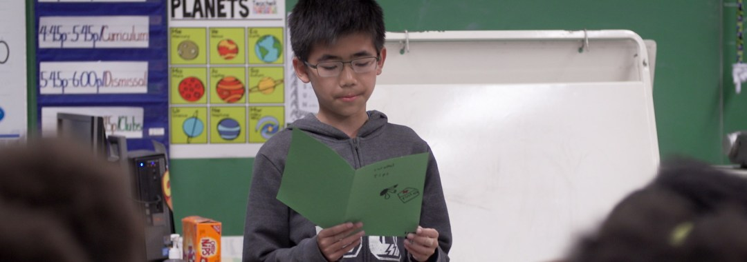 A HEAF student reads aloud to his class