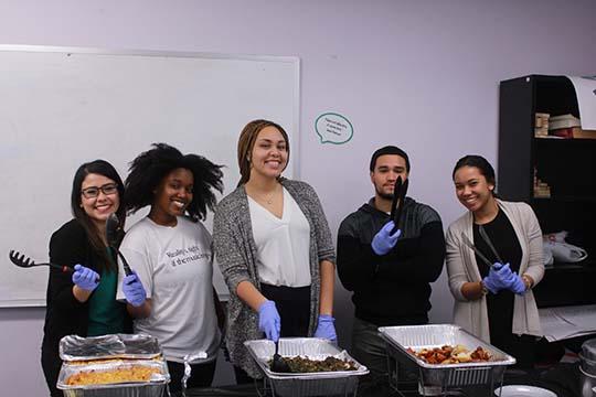 HEAF volunteers serving food