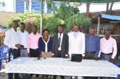 Heal The Planet Executive Board Members with Bishop Peter Kingoro at the Laucnh oh HTP Programs at Subway Restaurant Kampala, 14th May 2014