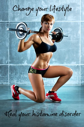 Young sports woman with barbell.