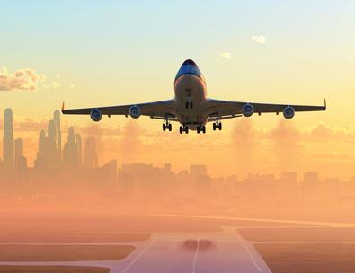 airplane taking off at sunrise