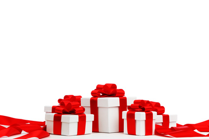 Holiday presents wrapped in white paper with red ribbons, isolated on white