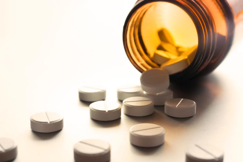 White pills in a bottle