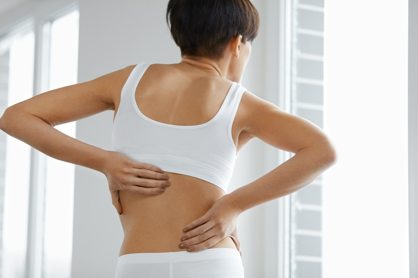 Back Pain. Closeup Of Beautiful Woman Having Spinal Or Kidney Pain, Backache. Female Suffering From Painful Feeling, Muscle Or Nerve Pain, Holding Hands On Body. histamine and nerve pain
