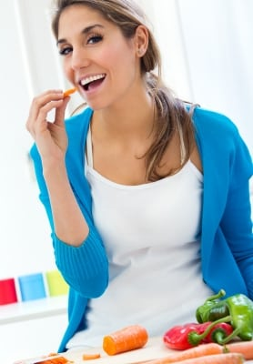 Pretty Young Woman Eating Salad