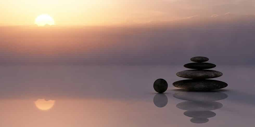 Balancing Stones Reflected on Water