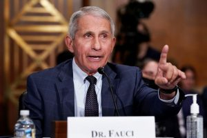 Fauci defends the FDA panel's decision to turn down the third dose for all Americans