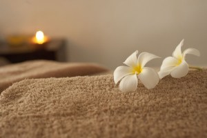 Towel with Flower and candle in background
