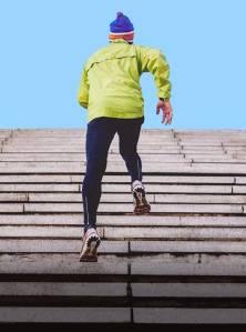 A man running up steps.