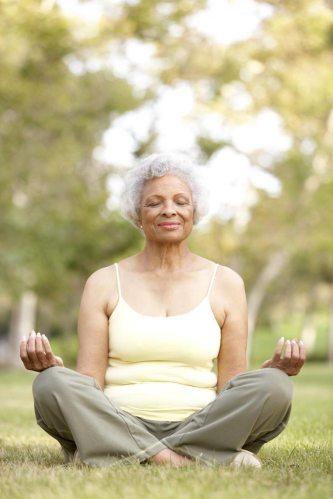 Image of senior woman practicing yoga