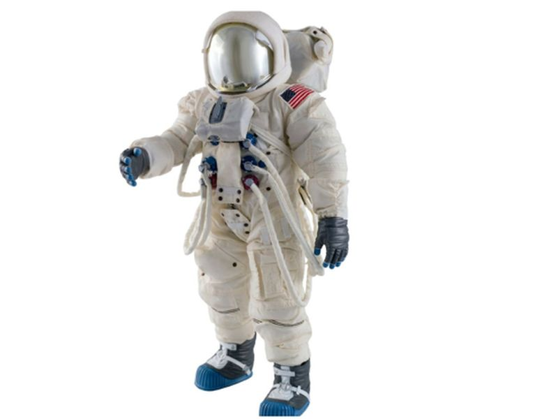 Astronaut wearing spacesuit against a white background, USA.