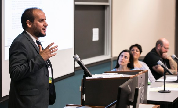 Fernando De Maio, associate professor of sociology at DePaul University, introduces the morning's panelists at the annual Health Disparities and Social Justice Conference Friday, Aug. 12, 2016, on the Loop campus. Jana Hirschtick, Sinai Urban Health Institute, Magdalena Nava, the Greater Humboldt Park Community Diabetes Empowerment Center and Noam Ostrander, DePaul's department of Social Work, lead the discussion. (DePaul University/Jamie Moncrief)