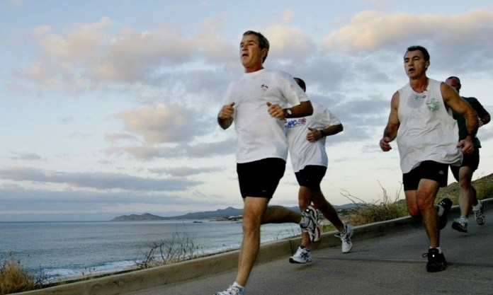 File photo of U.S. President George W. Bush jogging with U.S. Secret Service agents during the APEC Leaders' annual meetings in Los Cabos