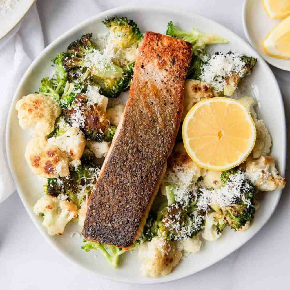 Healthy Crispy Salmon with Parmesan Oven Roasted Cauliflower and Broccoli - recipe by Healthful Blondie