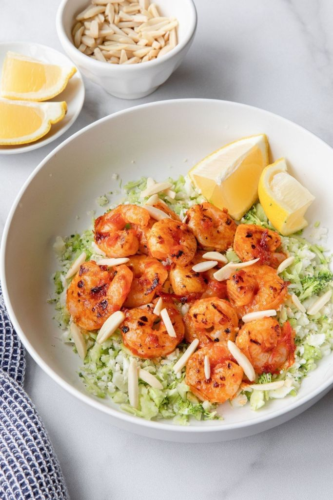 Super easy and flavorful harissa shrimp recipe. Marinated in a little honey for natural sweetness and topped with crunchy almonds, this dinner is the perfect healthy dinner.