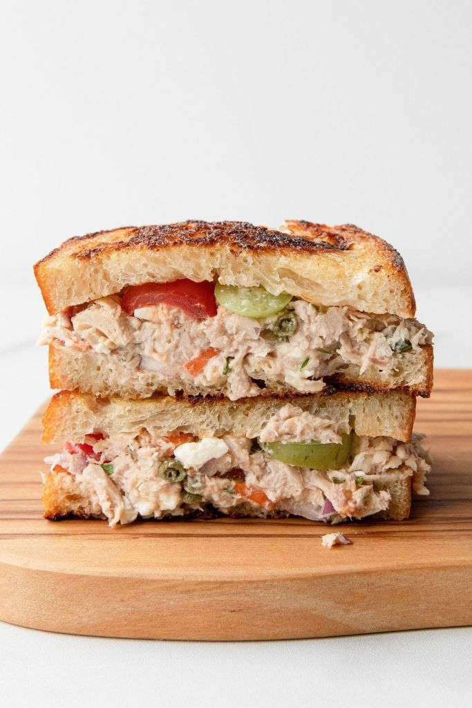 Mediterranean tuna melt sandwich with buttery toasted sourdough bread. Healthy lunch!