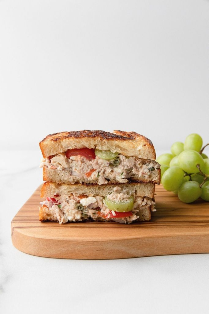 Healthy feta tuna melt sandwich with grapes and no mayo.