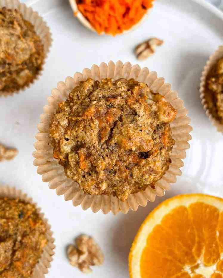 The best healthy spiced carrot orange muffins you'll ever make! Super fluffy and moist, with a great crunch from the chopped walnuts. Perfect carrot muffins for kids, athletes, and healthy people. If you meal prep, try these carrot muffins!