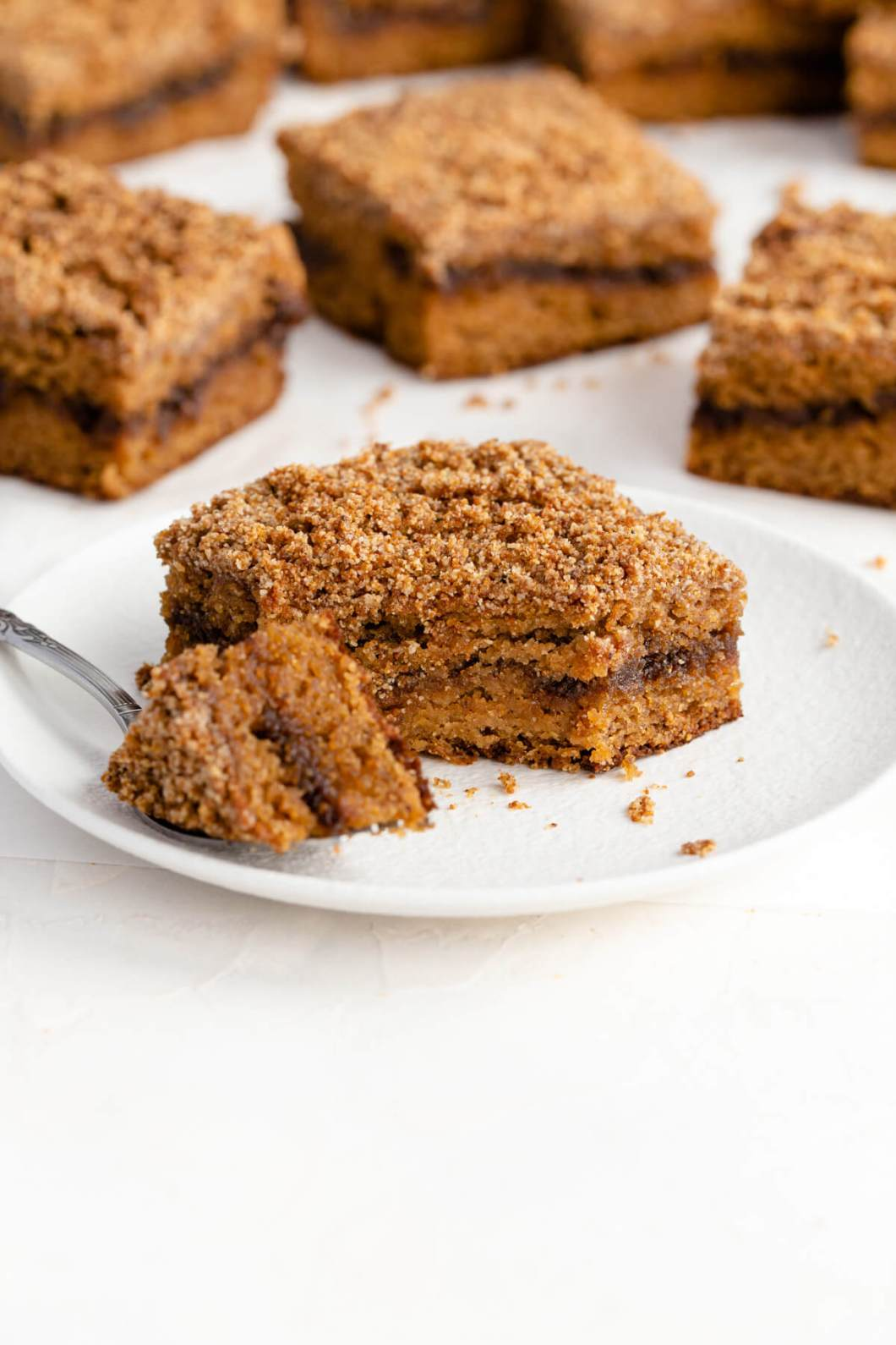 inside fluffy and buttery texture of a piece of healthy cinnamon swirl coffee cake with a crumble topping