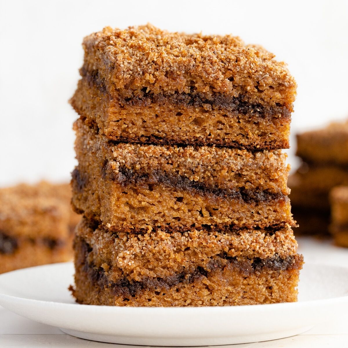 stack of healthy cinnamon swirl coffee cake with cinnamon sugar layer in the middle