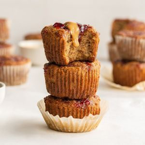 stack of three peanut butter and jelly banana bread muffins