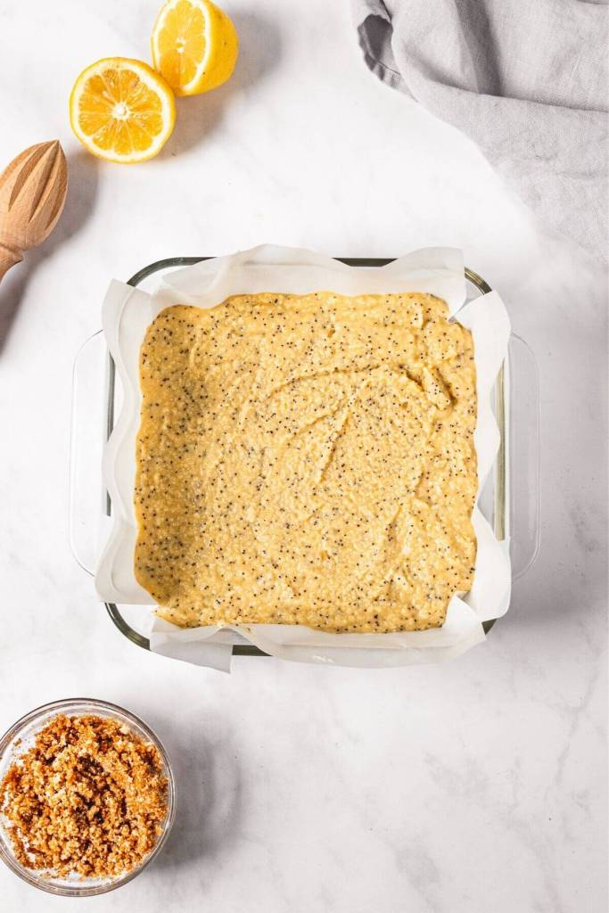 healthy lemon poppy seed cake batter in pan