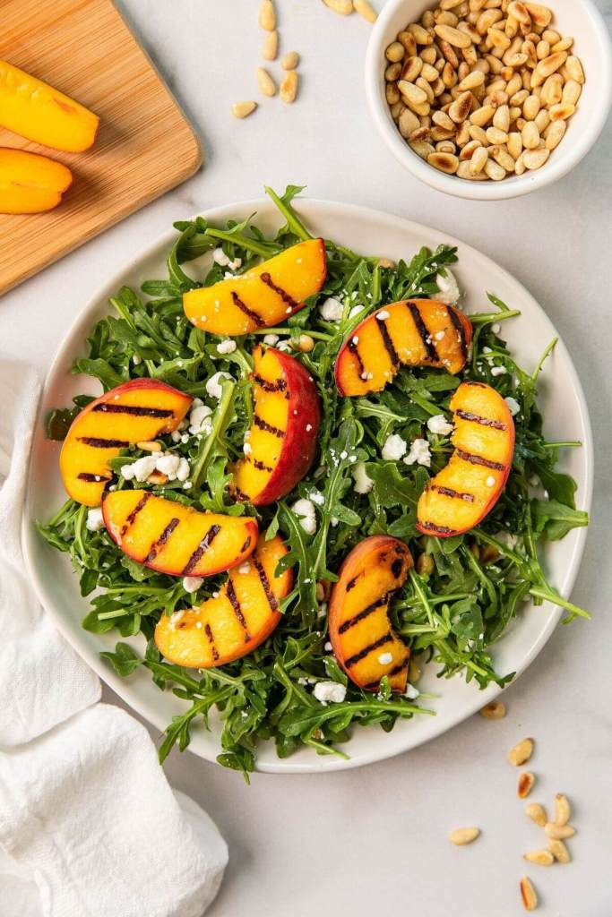 grilled peaches on arugula and goat cheese salad