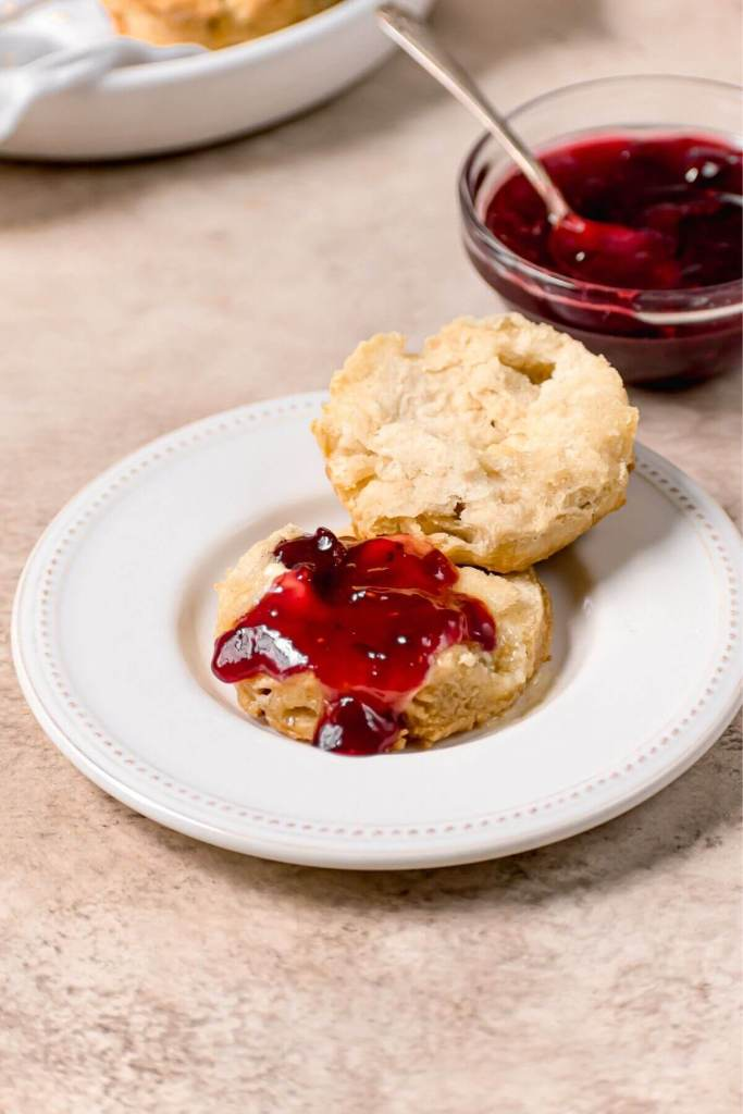 fluffy almond milk biscuit cut open with jelly and butter