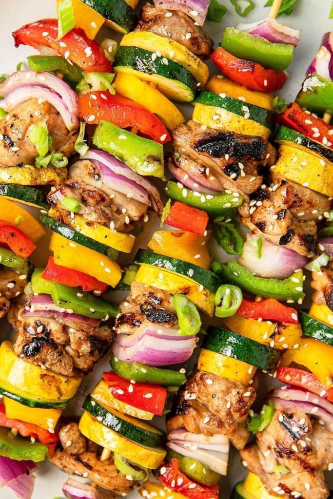 juicy miso glazed chicken thigh vegetable skewers up close