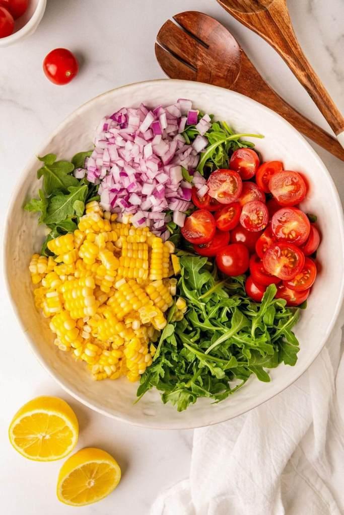 ingredients in fresh corn arugula salad
