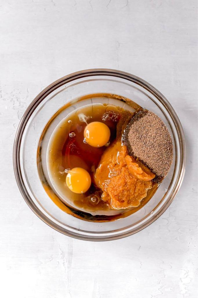 canned pumpkin puree with eggs in a bowl