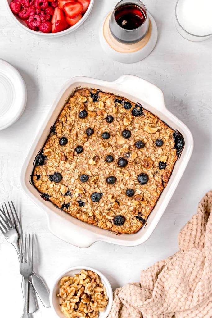 healthy vegan baked oatmeal in dish with blueberries