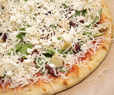 Naan bread makes for a fast, easy, and delicious pizza crust. In only 15 minutes, you can have pizza for dinner in your own home tonight!
