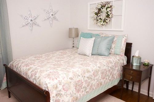 Look at this amazing budget friendly guest room transformation. New paint and repurposed decor helped make this incredible change possible.