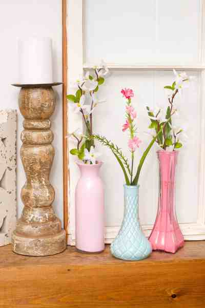 These easy DIY painted vases are a simple and cheap way to update your decor. With only a few dollars, you can create vases to match your own personal style.