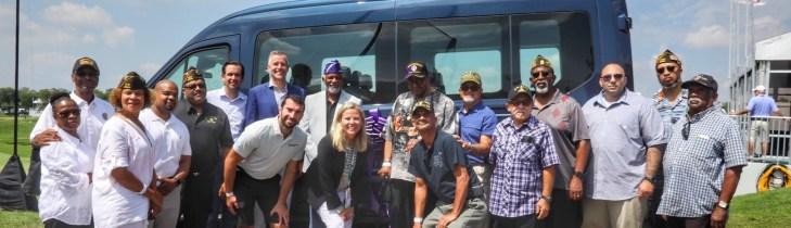 group posing with van