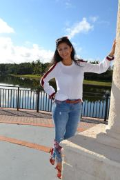 lady standing beside a lake